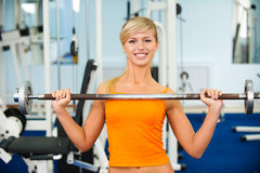 Girl with weight Royalty Free Stock Images