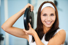 Girl with weight. Portrait of sporty girl posing with single weight Royalty Free Stock Photos