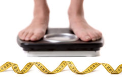 Girl and weight loss Stock Images