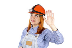 Girl welcomes the builder of hard hat Stock Photos