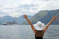 The girl welcomes the cruise ship Kotor bay Montenegro. Summer vacation stock image