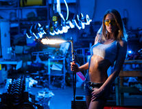 Girl with a welder Stock Photography