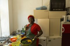 Girl from West Africa in the kitchen. Portrait of the girl from West Africa in her kitchen Royalty Free Stock Images