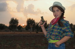 Girl in western clothes Royalty Free Stock Images