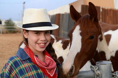 Girl in western clothes with a horse Royalty Free Stock Image