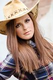 Girl with western hat. Cowgirl with  hat in the western town Royalty Free Stock Photo