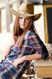 Girl with western hat. Cowgirl with hat in the western town Royalty Free Stock Image