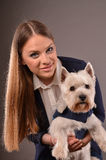 Girl and Westie Royalty Free Stock Photos