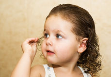 Girl with wet hair. Portrait of a little girl with a wet head Royalty Free Stock Photo