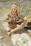 A girl in a wet shirt . A girl in a wet shirt on the beach Royalty Free Stock Photography
