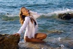 Girl in a wet white shirt stock photos