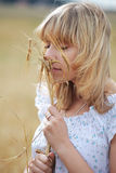 Girl with wheat Royalty Free Stock Photography