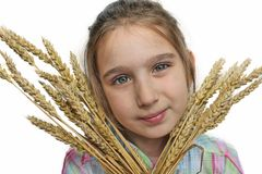 Girl and wheat Stock Photos
