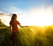 Girl on wheat fieald Royalty Free Stock Photos