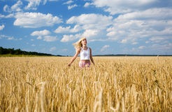 Girl in the wheat field Royalty Free Stock Image