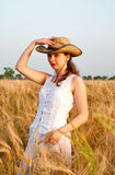 Girl in wheat field Royalty Free Stock Images