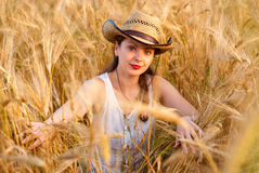 Girl in wheat field Stock Photos
