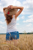 Girl on a wheat field Royalty Free Stock Photos