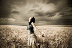 Girl at wheat field. Royalty Free Stock Photo