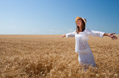 Girl on wheat field Royalty Free Stock Photography