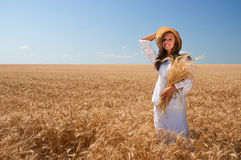 Girl on wheat field Royalty Free Stock Photos