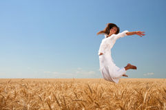 Girl on wheat field Royalty Free Stock Photos