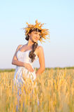Girl on wheat field Royalty Free Stock Images