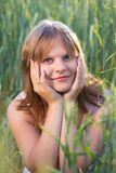 Girl In A Wheat Field Royalty Free Stock Images
