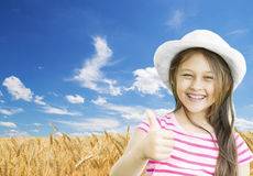 Girl and wheat field Royalty Free Stock Photo