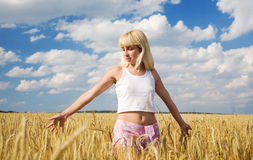 Girl in the wheat field Stock Images