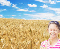 Girl and a wheat field Stock Photo