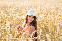 Girl on wheat field Stock Photo
