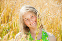 Girl on wheat field Stock Image