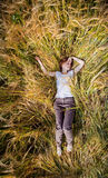 The girl in a wheat field Royalty Free Stock Photo