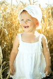 Girl in a wheat field Royalty Free Stock Photos