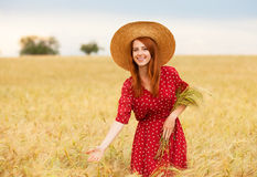 Girl at wheat field Stock Image