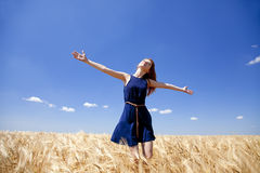 Girl at wheat field in summer day. Stock Image