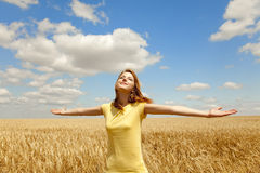 Girl at wheat field at summertime. Royalty Free Stock Image