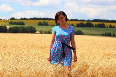 Girl in wheat field. Girl walking in the field with wheat stock photo
