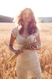 Girl in wheat field in the wind. Person and nature Royalty Free Stock Images