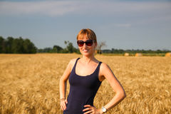 A girl in a wheat field stock photo