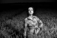 Girl in wheat field Royalty Free Stock Image