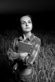 Girl in wheat field Stock Images