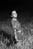 Girl in wheat field Stock Photos