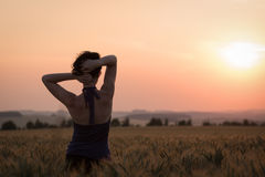 Girl in Wheat Field Royalty Free Stock Photos