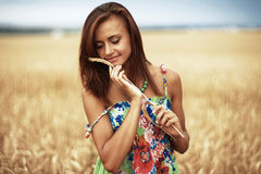 Girl in wheat meadow. Photo of glad girl enjoying life in wheat meadow Stock Image