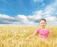 Girl and wheat Stock Photography