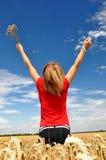 Girl in a wheaten field Stock Photo