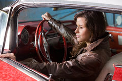 Girl at the wheel Royalty Free Stock Photography