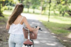 girl wheel bicycle to bike lane in park royalty free stock photo
